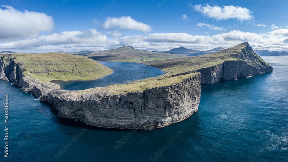 Leitisvatn lake and Bosdalafossur waterfall on Vagar island aerial view, Faroe Islands