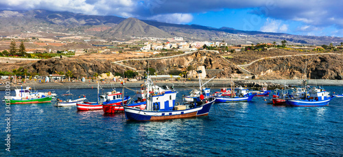 Tenerife holidays. Playa San Juan -pictorial beach with traditional boats . Canary islands