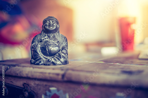 Foto Spirituality and feng shui concept: Buddha statue in the living room