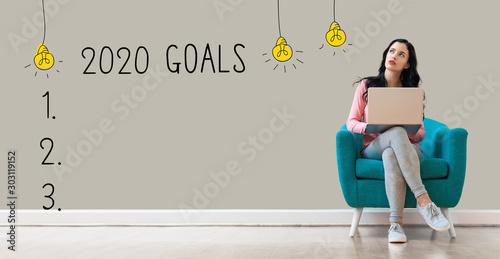 Fototapeta 2020 goals with young woman using a laptop computer obraz na płótnie