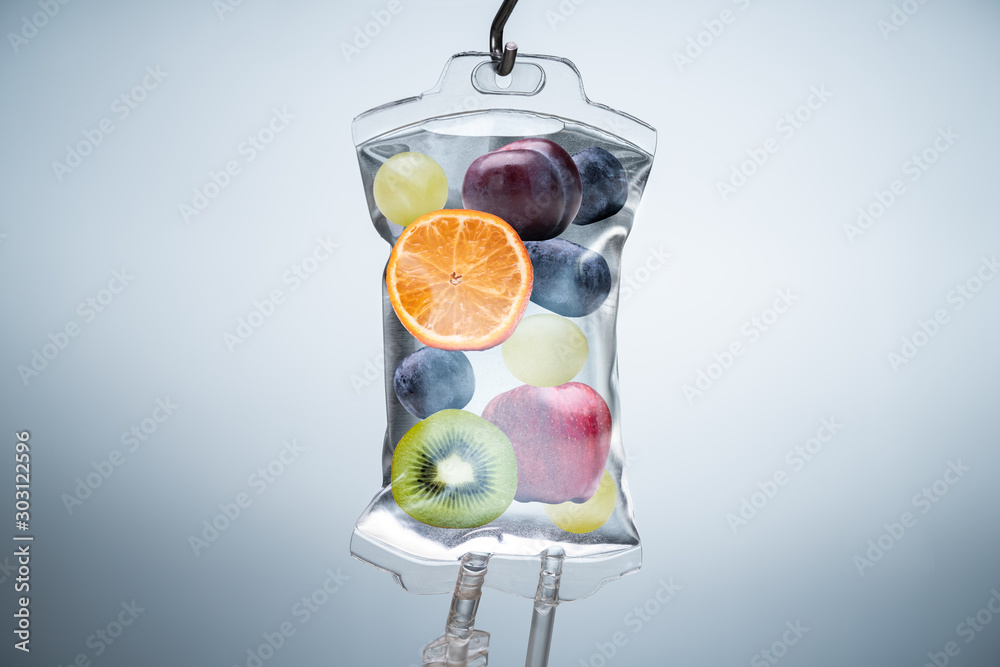 Obraz Different Fruit Slices Inside Saline Bag Hanging In Hospital fototapeta, plakat