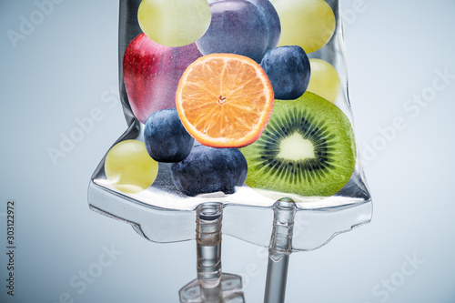 Fototapeta Different Fruit Slices Inside Saline Bag Hanging In Hospital obraz