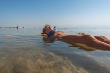 Swimmer In Salty Water Of Dead Sea.