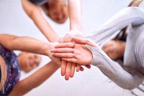 Fototapety, obrazy: Young beautiful group of sportswomen standing shaking hands after class of yoga at gym