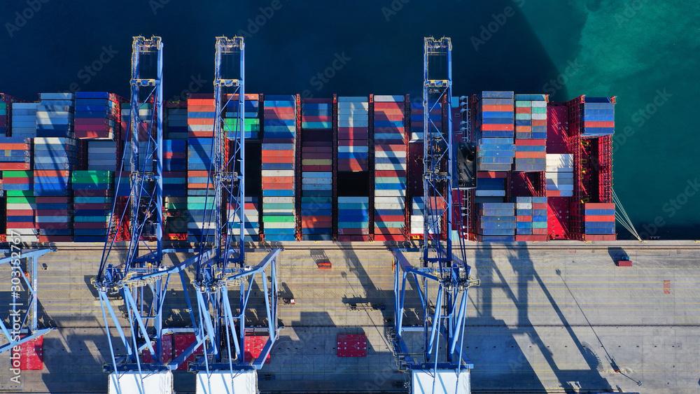 Fototapeta Aerial top down photo of industrial cargo container logistics terminal