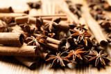 Star anise, cinnamon. Aromatic spices on wooden background. Top view. Close up. Seasoning ingredients for cooking or baking
