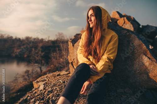 Foto auf Leinwand Dunkelbraun Traveler woman portrait sitting on the nature near quarry