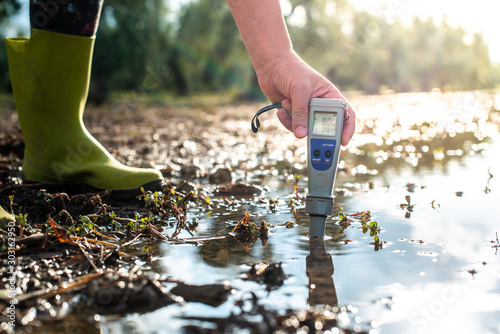Photo  Measure water content with digital device.  PH meter.