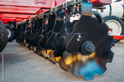 Fototapeta Working parts of new modern agricultural disc harrow for tillage
