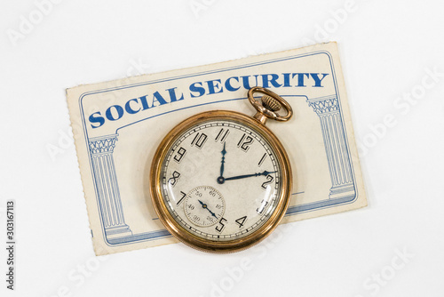 Old Social Security card with antique pocket watch and white background.   #303167113