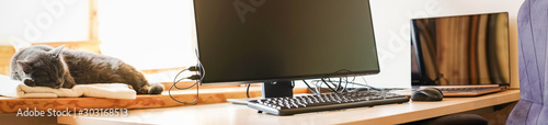 Obraz Working place with IT equipment at home. Flexible hours and remote working concept. Panorama. - fototapety do salonu