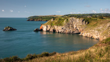 A Bright Sunny Day With A Landscape Looking Up The Coast From Berry Head In Devon And Showing The Cliffs And Sea