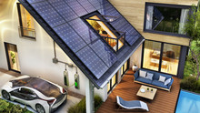 Electric Car And Modern House With Solar Panels On The Roof