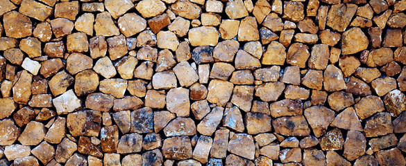 Stones, rocks and boulders - as a stone wall background texture / abstract design.