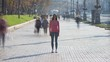 The young woman stands in crowdy flow. time lapse