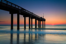 Sunrise At St. John's Pier, St. Augustine, Florida.