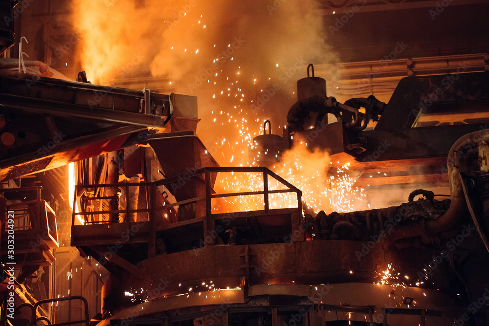 Fototapety, obrazy: Melting of metal in a steel plant. High temperature in the melting furnace.