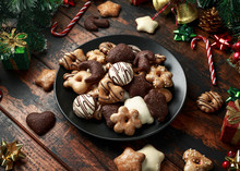 Christmas Gingerbread, Lebkuchen Mix With Decoration, Gifts, Green Tree Branch On Wooden Rustic Table