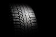 canvas print picture - Winter high performance studless tire on black background