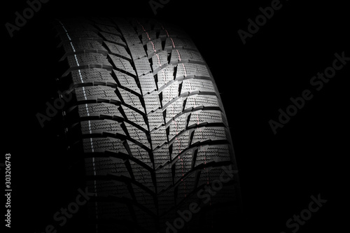 Fotografía  Winter high performance studless tire on black background