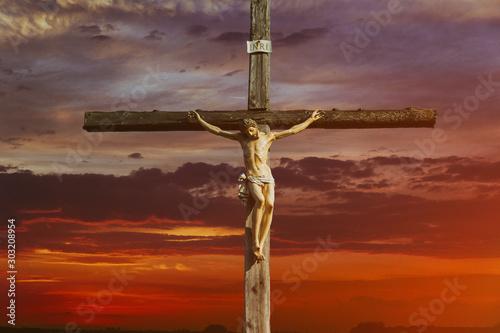 Valokuva Jesus christ on cross over sunrise he is risen victory in easter day, good frida