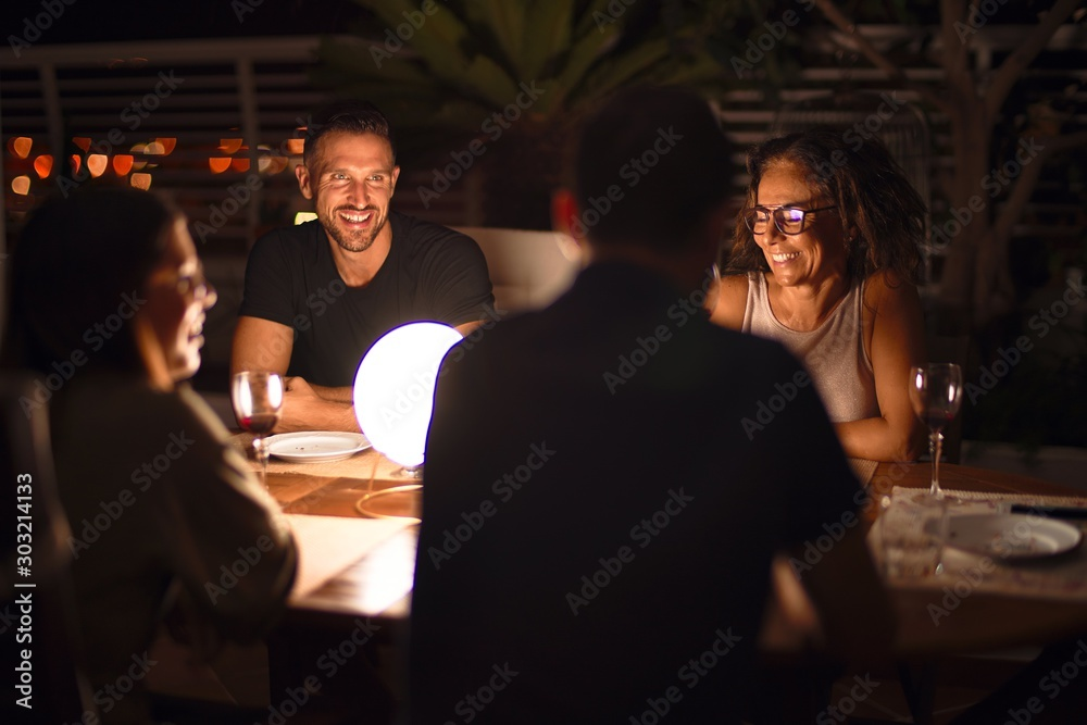 Fototapeta Beautiful family on dinner talking and smiling at terrace