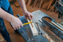 Carpenter With Ruler Measuring...