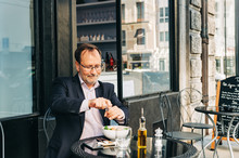 Businessman Having Lunch On A ...