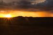 canvas print picture - Sonnenuntergang und Gewitterregen am Horizont