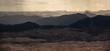 Siluette der Berge im Guab Valley in Namibia bei Regen und Sonne
