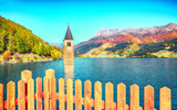 Fantasic autumn view of submerged bell tower in lake Resia