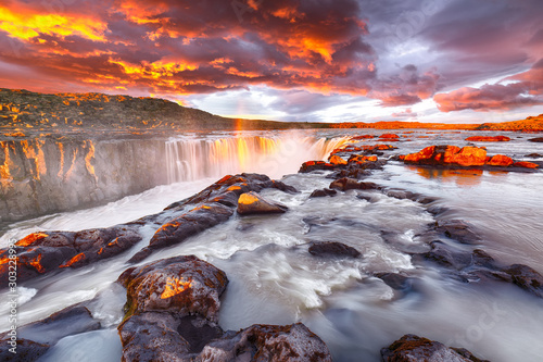Fototapeta Dramatic sunset view of fantastic waterfall and cascades of Selfoss waterfall