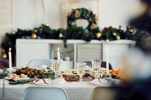 Foto op Aluminium Kruidenierswinkel Background image of beautiful table setting for Christmas party with fir elegant candles and delicious homemade food, copy space
