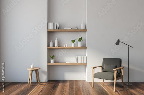 Fototapeta White living room with armchair and shelves