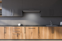 Gray Kitchen With Wooden Count...
