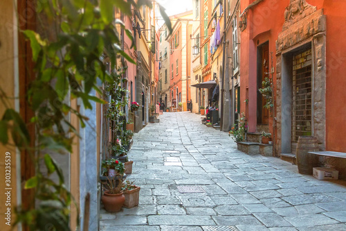 Fototapety, obrazy: View of red and orange houses with flowers of old street Riomaggiore, Cinque Terre, Liguria, Italy