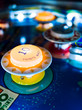 Antique Pinball Machine Bumpers with Motion Blur Ball