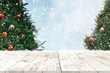 Leinwanddruck Bild - Top of empty wood table with beautiful Christmas tree and snowfall  backdrop. ready for your product display or montage. Concept of background in Christmas and New year holidays.