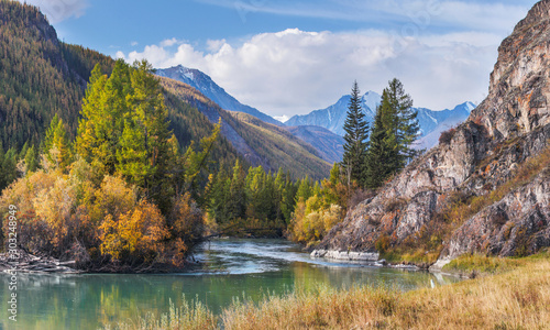 Mountain landscape, autumn view. A river in a picturesque gorge, a forest on the banks.