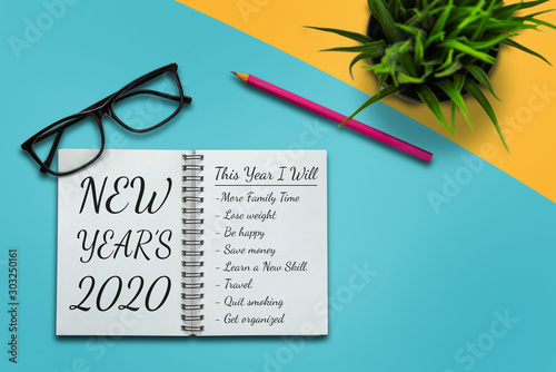 Poster Pays d Europe New Year Resolution Goal List 2020 - Business office desk with notebook written in handwriting about plan listing of new year goals and resolutions setting. Change and determination concept.