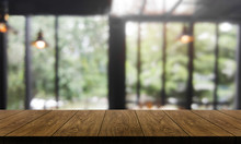 Wood Table In Blurry Backgroun...