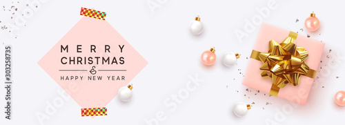 Fototapeta Holiday Christmas Banner. Xmas background with realistic pink gift boxes, white rose color balls. Horizontal poster, header for website, greeting card. Advertising flyer brochure. soft pastel colors obraz na płótnie