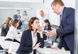 Serious boss scolding female subordinate