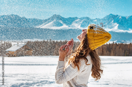 Obraz Happy young girl playing with snow - fototapety do salonu