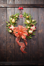 Christmas Wreath On Dark Woode...