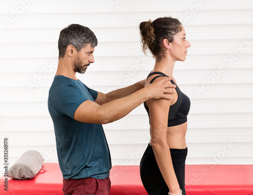 Male osteopath doing a postural evaluation Canvas