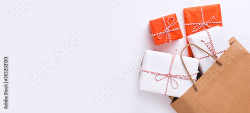 Eco Shopping bag with colorful gift boxes on white Wallpaper Mural