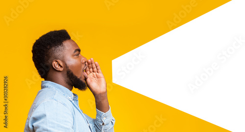 Guy making loud announcement at copy space on yellow background Fototapet