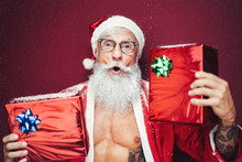 Happy Santa Claus Holding Christmas Presents - Hipster Bearded Senior Having Fun Wearing Xmas Clothes Celebrating Holidays - Elderly Trendy People And Traditional Lifestyle Culture
