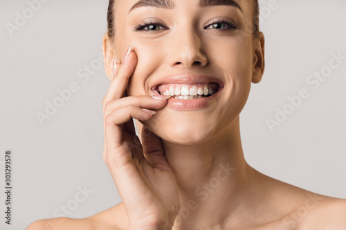 Stomatology concept. Girl with strong white teeth